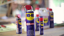 How does WD-40 remove and drive out moisture?
